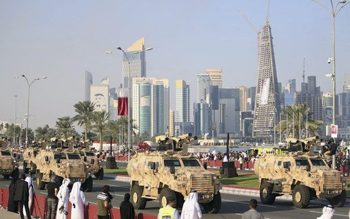 Serdar remote weapon stations are seen fitted to Ejder Yalçin  vehicles during Qatar's military parade on 18 December 2018. (Arif Akdogan/Anadolu Agency/Getty Images)