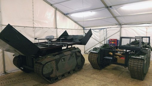 The two configurations of the THeMIS that participated in Exercise 'Autonomous Warrior': the one on the left is equipped with the KX-4 LE Titan unmanned aerial vehicle (UAV) while the one on right is the logistics version that can carry a payload of 750 kg. (IHS Markit/Melanie Rovery)