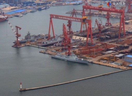 The two most recently launched Type 052Ds are seen here in the dry dock closest to the water a few days prior to launch at Dalian. Also visible, but afloat, are a Type 055 and 052D destroyer launched a few months ago, while at the rear of the dry dock are a Type 055 and 052D that are currently under construction. (Via haohanfw)