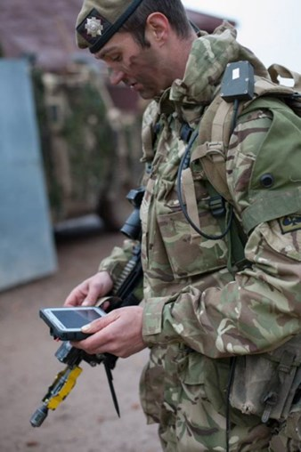 A Scots Guards sergeant with an infantry terminal introduced as part of the infrastructure element of BCIP 5.6. (British Army)