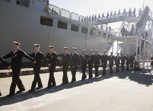 The crew of HMAS Success march off the ship for the last time during the AOR's decommissioning ceremony on 29 June at Fleet Base East, Sydney. (RAN)