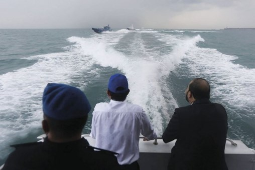 Chief Minister of Johor, Osman Sapian (centre), surveying the disputed waters in a Malaysia Marine Department vessel, with patrol boats from the Malaysia Maritime Enforcement Agency (MMEA) and the Singapore Police Coast Guard (background) tailing behind. (Osman Sapian via Facebook)