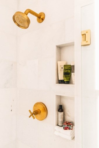 Manhattan Polished Marble Bathroom Shower Wall Tile from Arizona Tile with Gold Fixtures