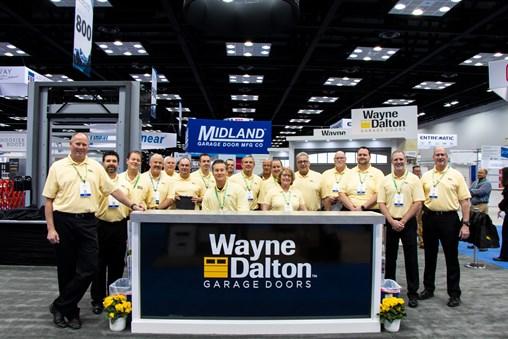 Wayne Dalton representatives in front of a Model 8450 Luminous® Door