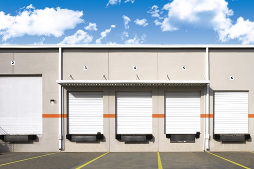 5 commercial Model C-24 sectional doors with Miami-Dade Wind Load Reinforcements