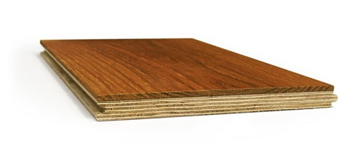 Wood flooring panels stacked on each other.