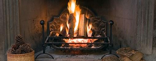 A closeup of a fire in a fireplace.