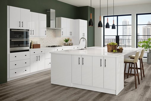 A modern white kitchen with a green wall. All the furniture and flooring are pieced together in a finished kitchen.
