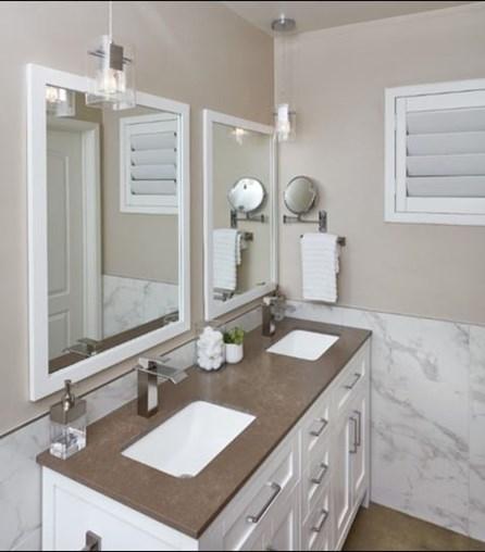 Metropolis Brown Quartz Slab Bathroom Countertop from Arizona Tile with Waterfall Faucets