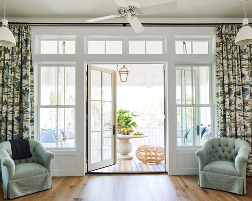 Large windows and patio door leading to porch.