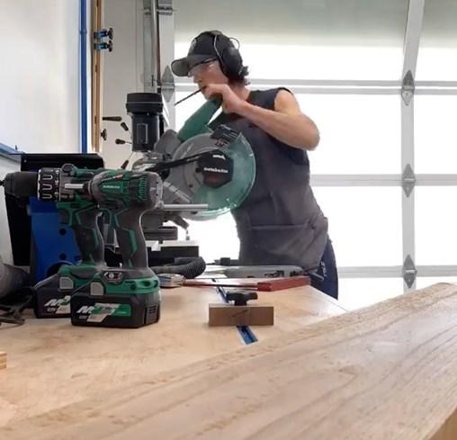 Actor Tanc Sade working in his garage