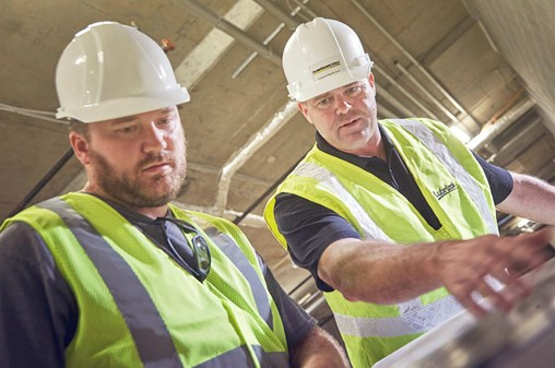 Contractors reviewing plans for building