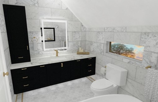 bathroom with black vanity and brushed brass fixtures