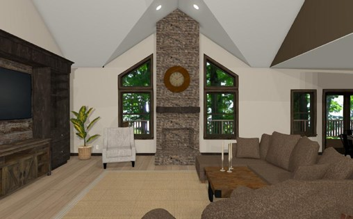 Wenzel project family room featuring a large stone fireplace and vaulted ceilings.