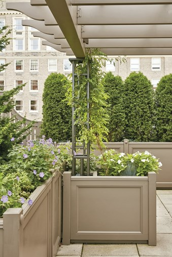 Planters act as support for this anchored-pergola.