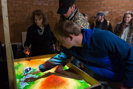 Students in the Department of Landscape Architecture learn about site engineering from Melissa Currie using the augmented reality sandbox.