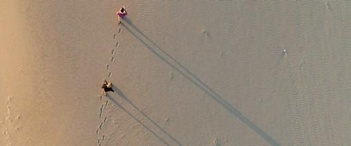 Beach walkers leave footprints on the beach