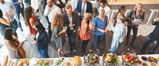 inclusive networking event with table of food | online community higher logic blog