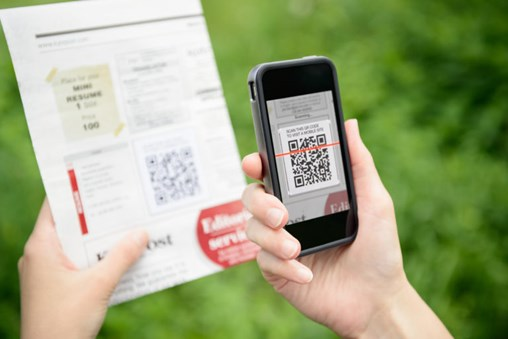 Scanning with QR code on mobile smart phone.