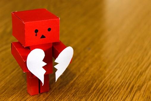 sad paper robot - quality stock images