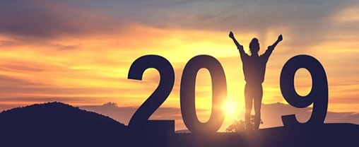 Silhouette young woman enjoying on the hill and 2019 years while celebrating new year
